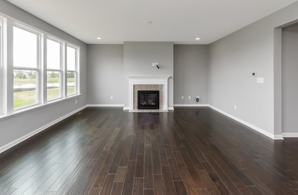 Shelby quick move-in Great room with cozy fireplace and hardwood floors