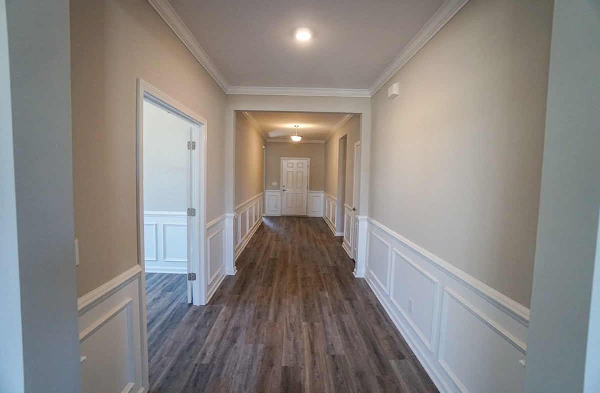 Southport quick move-in foyer features elegant trim and framing