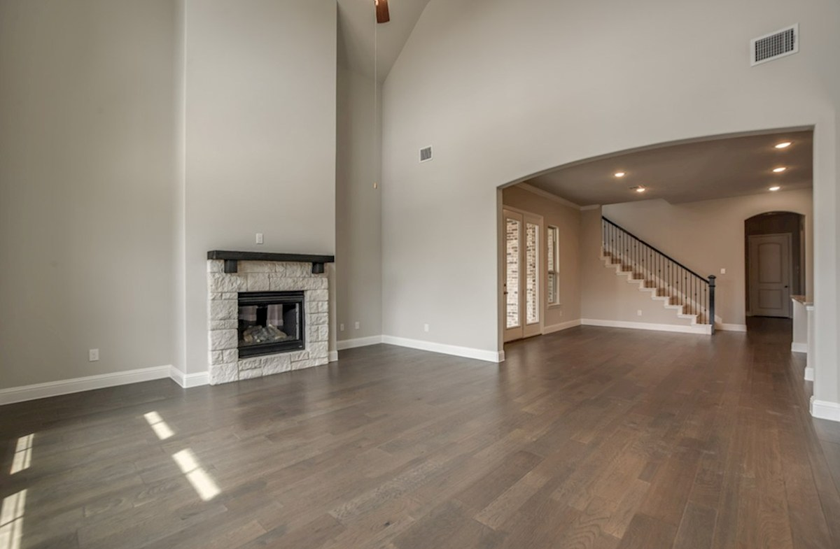 Brenham quick move-in open great room with wood floors and fireplace
