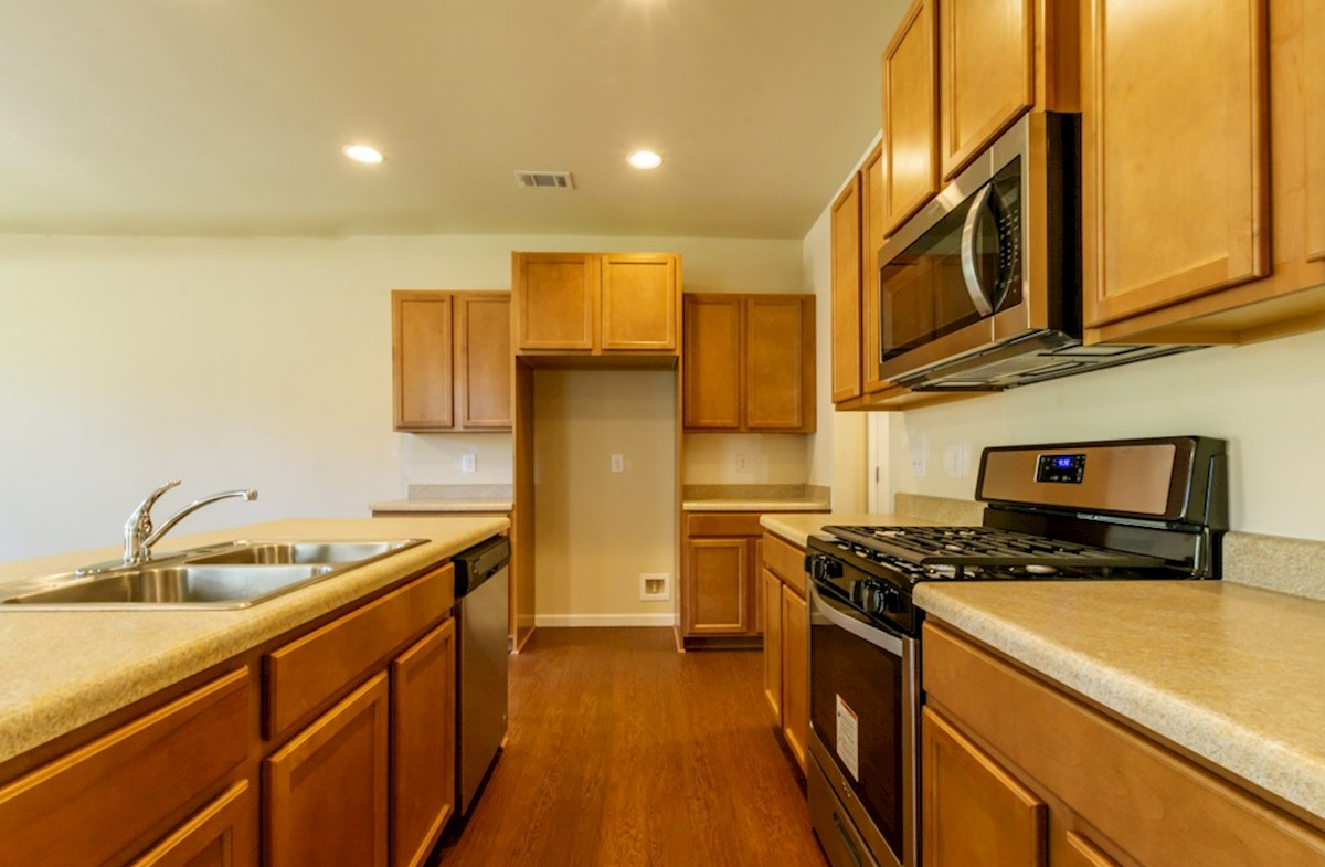 Hartwell quick move-in Kitchen with stainless steel appliances