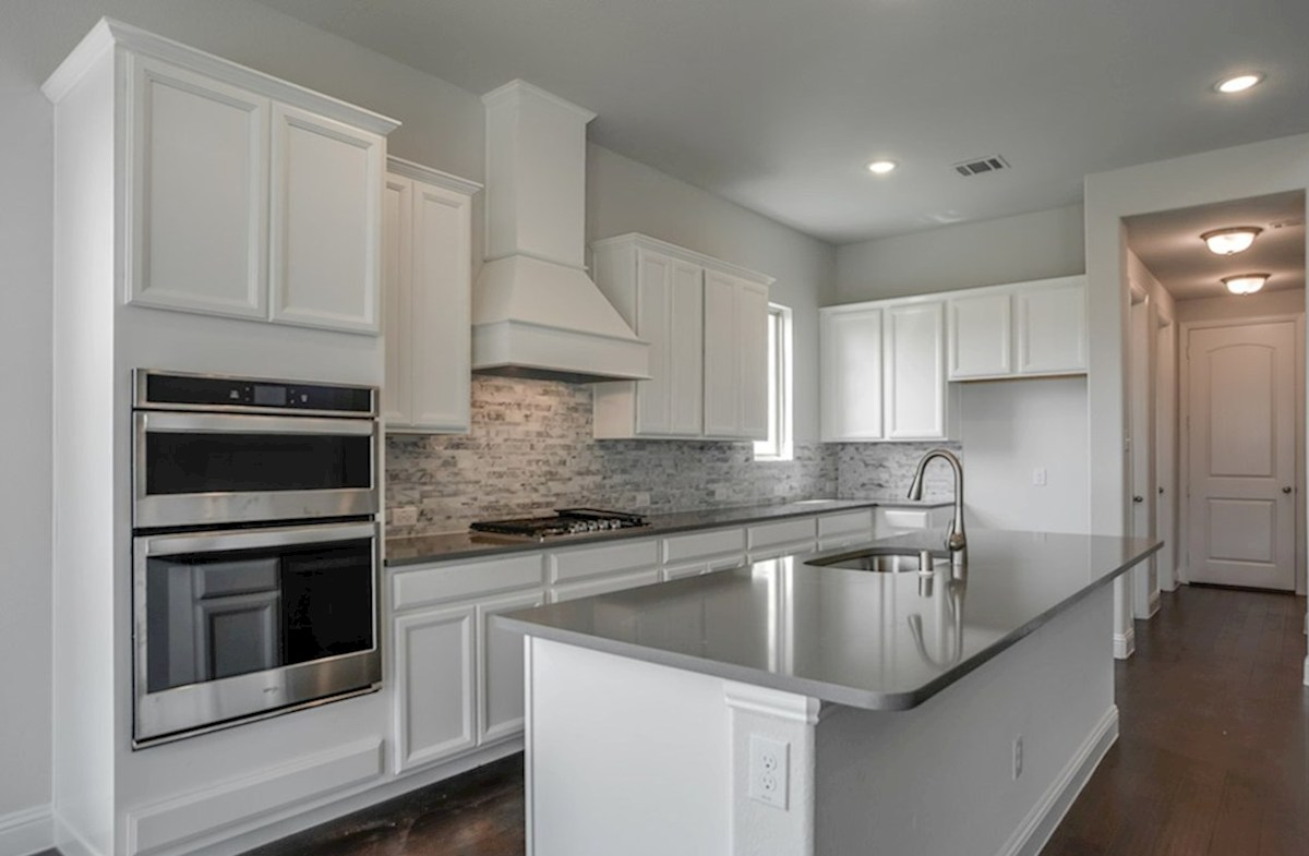 Summerfield quick move-in open kitchen with large island and white cabinets
