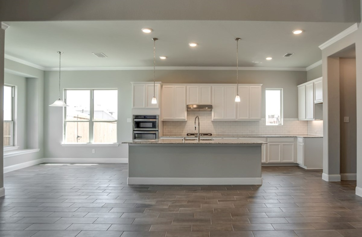 Summerfield quick move-in open kitchen and breakfast nook with wood floors