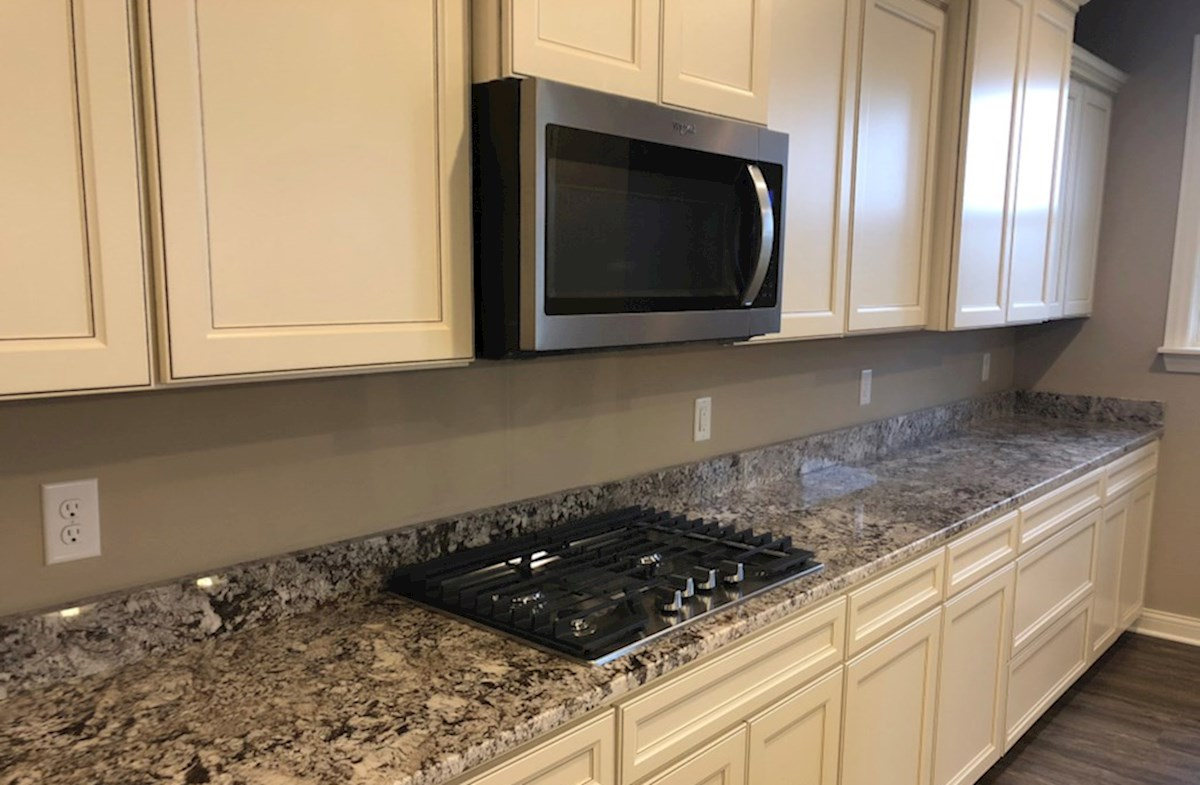 Oakhill quick move-in Gourmet kitchen complete with gas cooktop