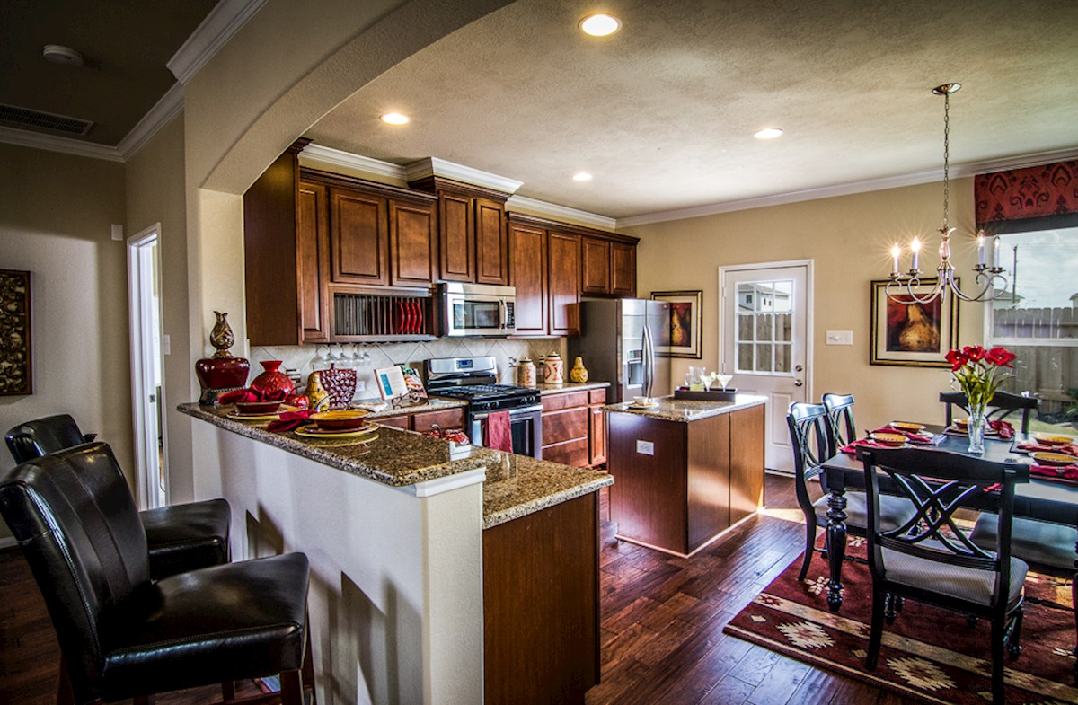 Villages at Harmony Maddox open kitchen with casual dining