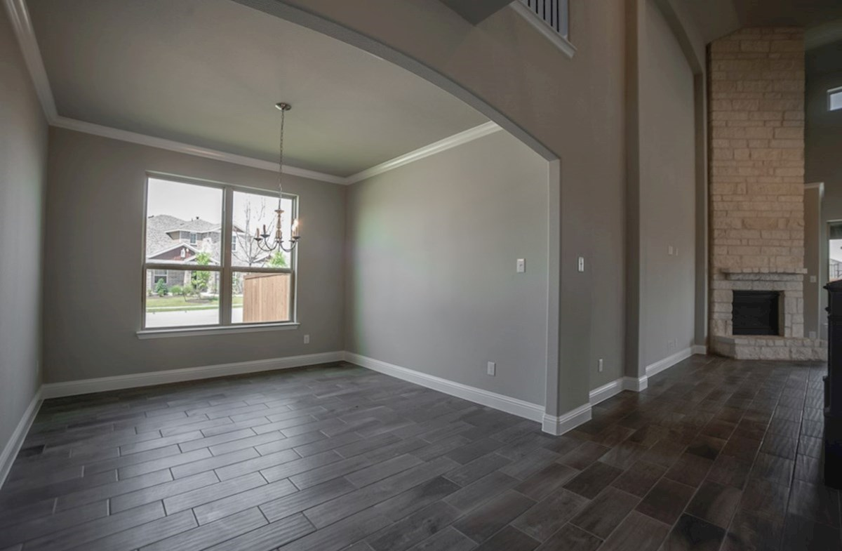 Summerfield quick move-in open dining room with large arch entrance