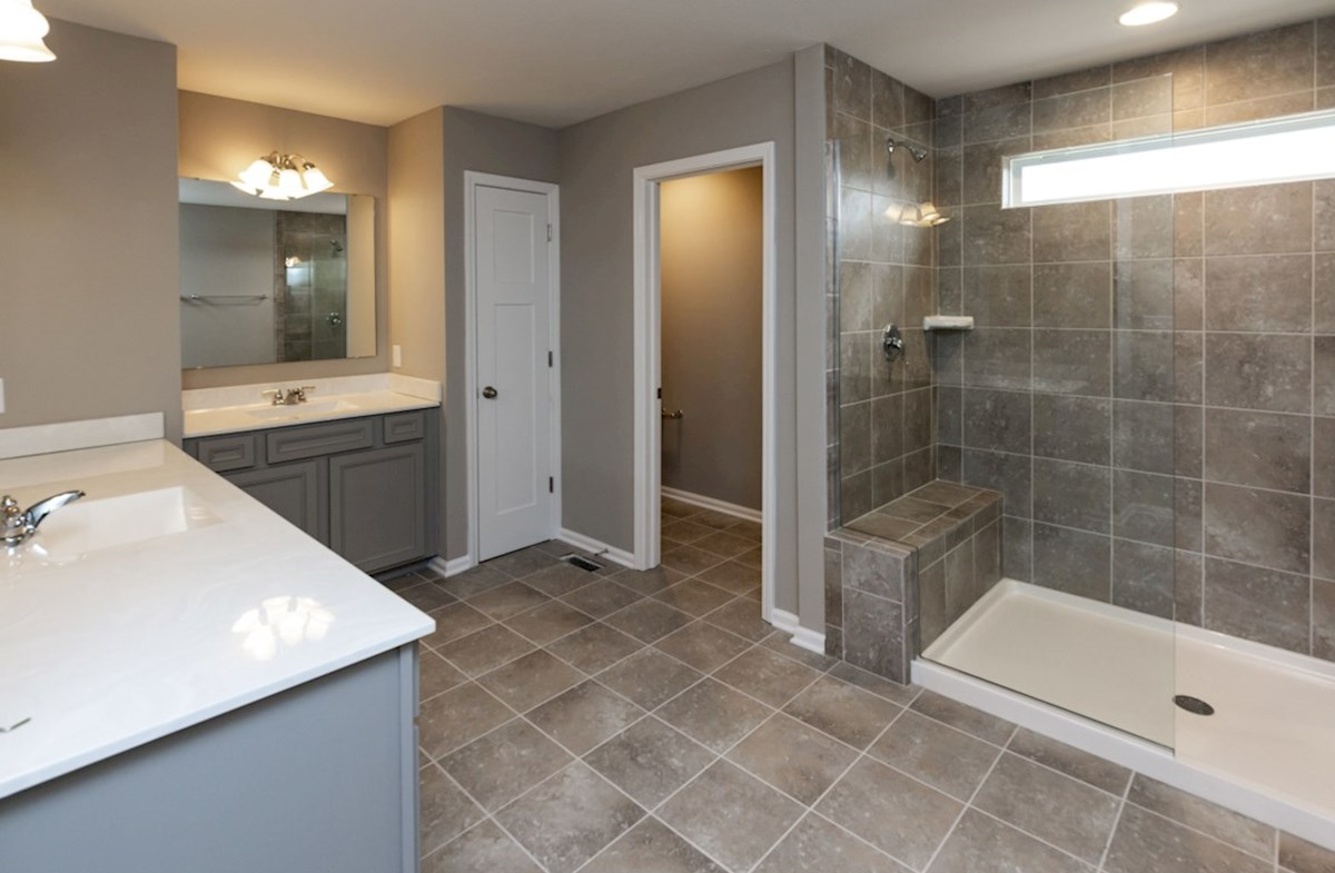 Shelby quick move-in master bath with dual sinks and spa shower