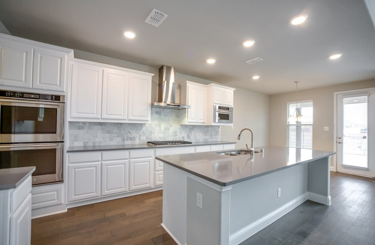 Madison quick move-in kitchen with granite countertops and stainless appliances