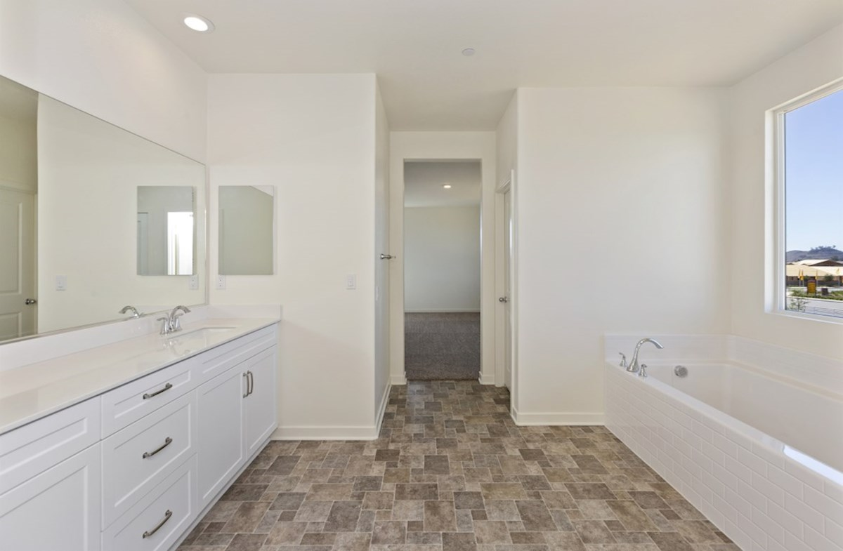 Reserve quick move-in Spa-inspired luxury abounds in the deluxe master bath, complete with separate shower and soaking tub