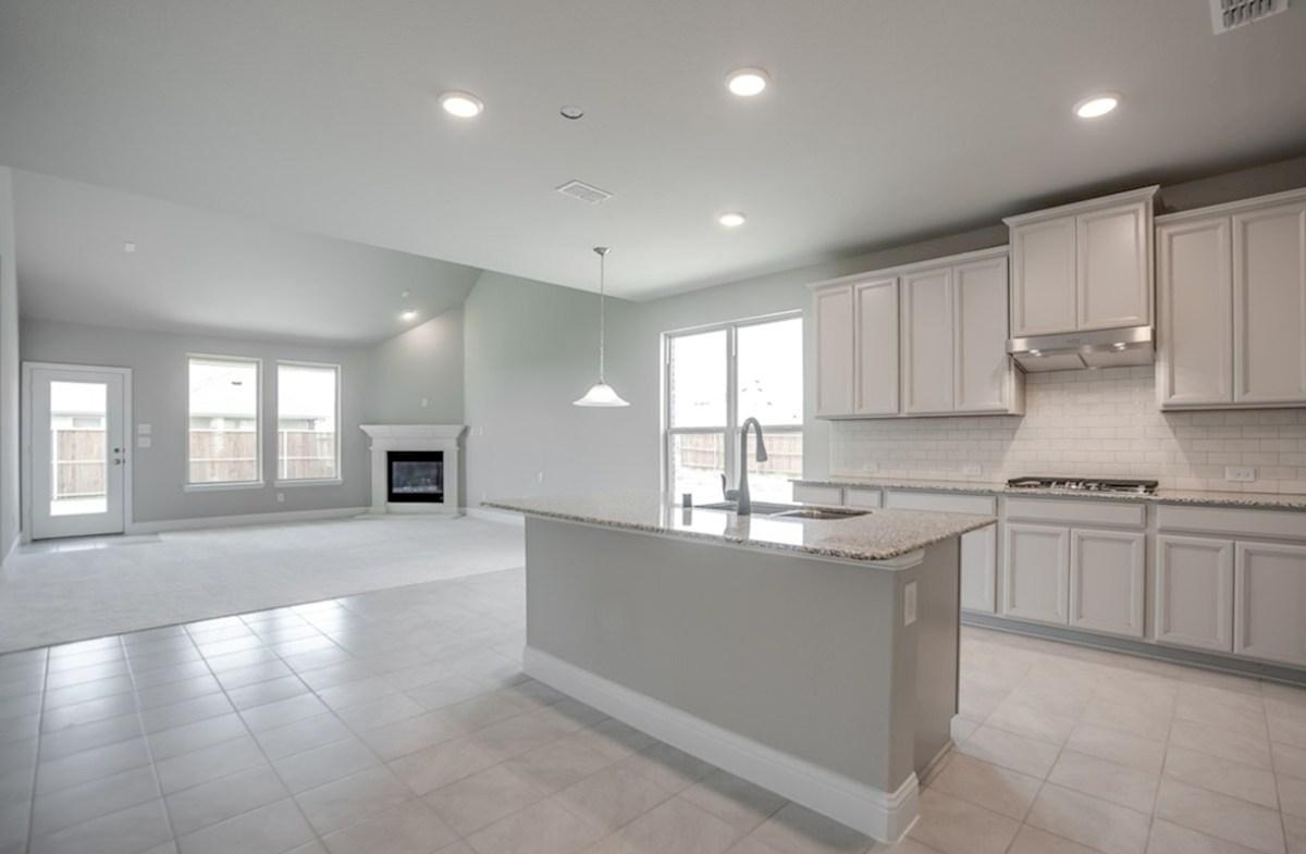 Prescott quick move-in open kitchen next to breakfast nook and great room