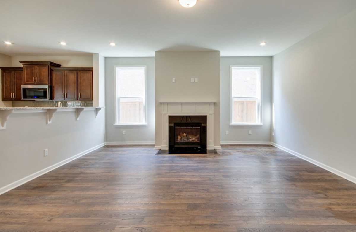 Harper quick move-in great room with hardwoods and fireplace