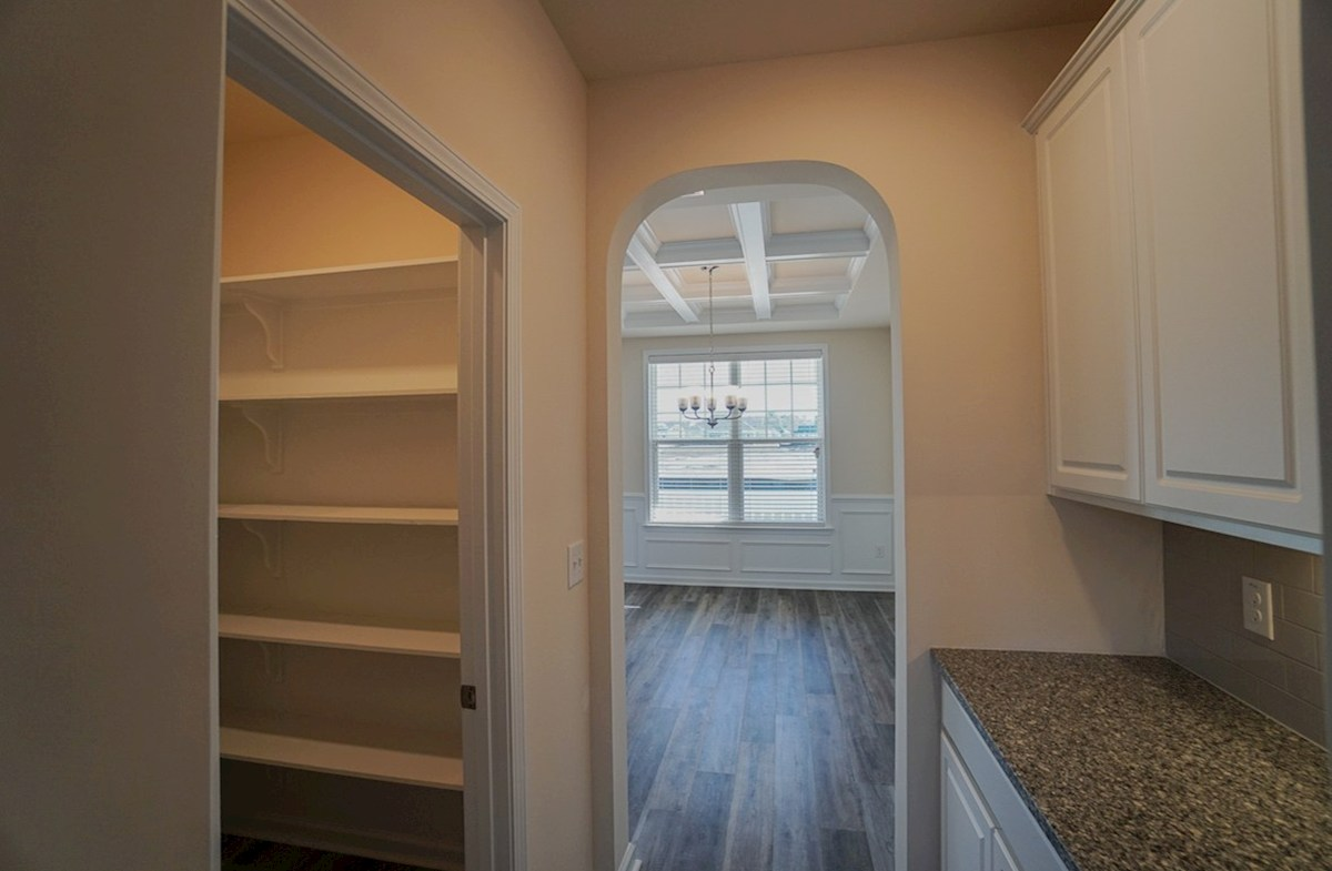 Ivey quick move-in pass-through features a large pantry and butler's area