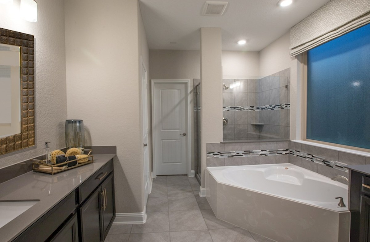 The Woodlands: May Valley Sedona master bathroom with tile and stone counters
