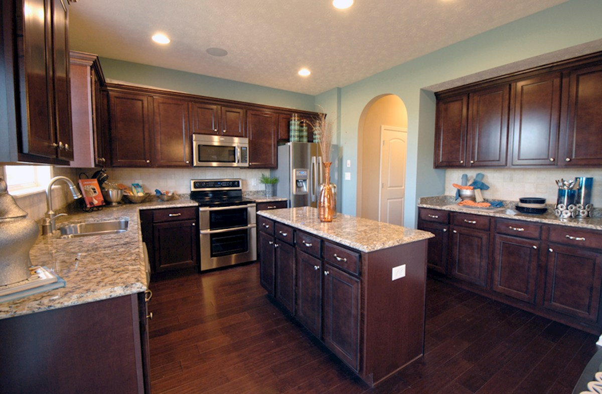Shadow Creek Farms Juniper kitchen with dark cabinets and granite counter tops