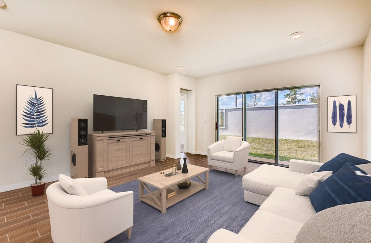 Avalon Park West Redington Furnsihed family room with large sliding glass door