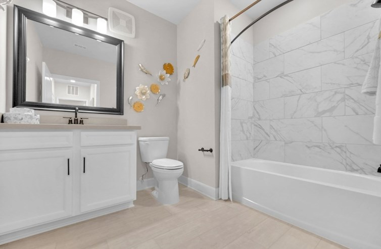 Wiltshire guest bathroom with vanity and shower