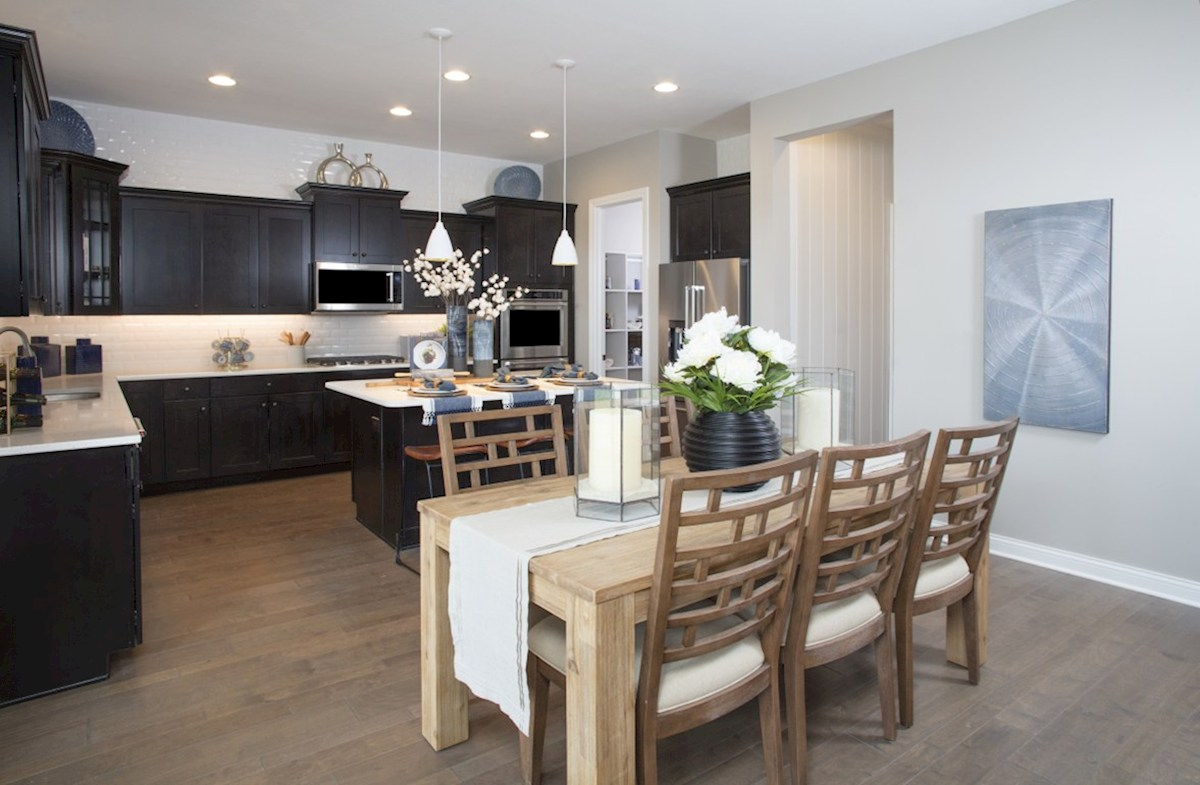 Hampshire Meridian Collection Tarkington open kitchen and breakfast area with hardwood floors