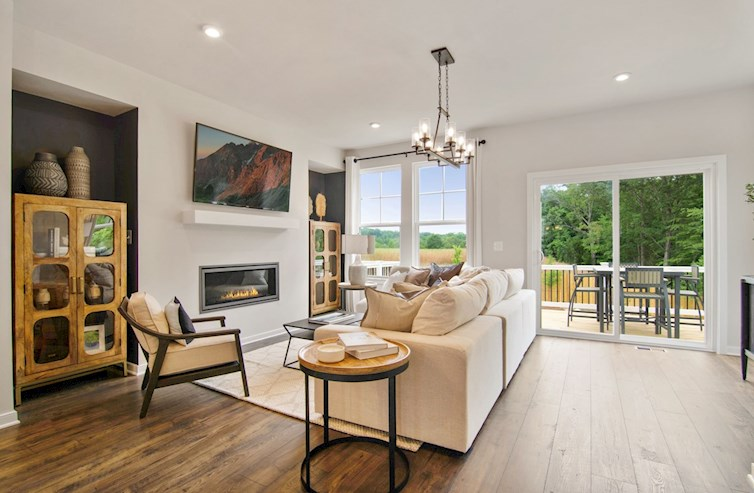 great room with fireplace & access to rear deck
