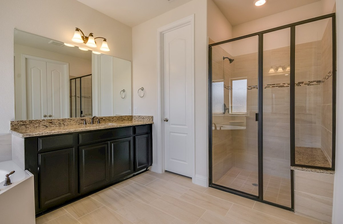 Kerrville quick move-in master bathroom espresso cabinets and large shower