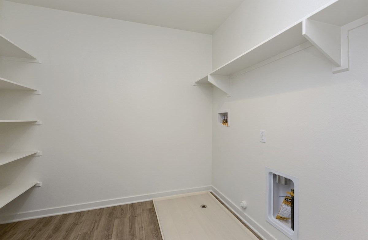 Paxton quick move-in Oversized laundry room so you can fit an ironing board and optional cabinets or countertops
