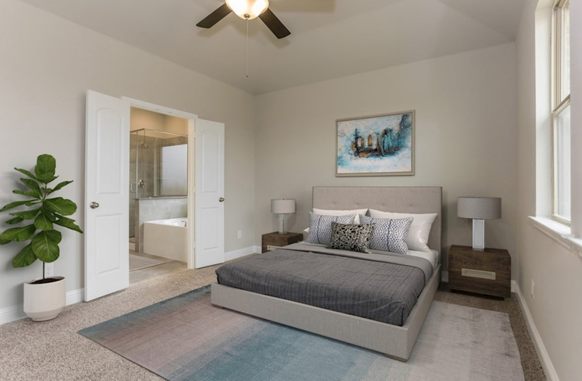 Bluewater Lakes Cascade master bedroom with carpet and ceiling fan