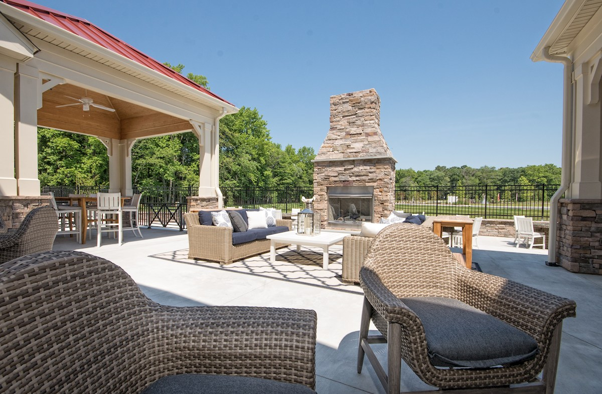 Spacious pool deck with outdoor fireplace