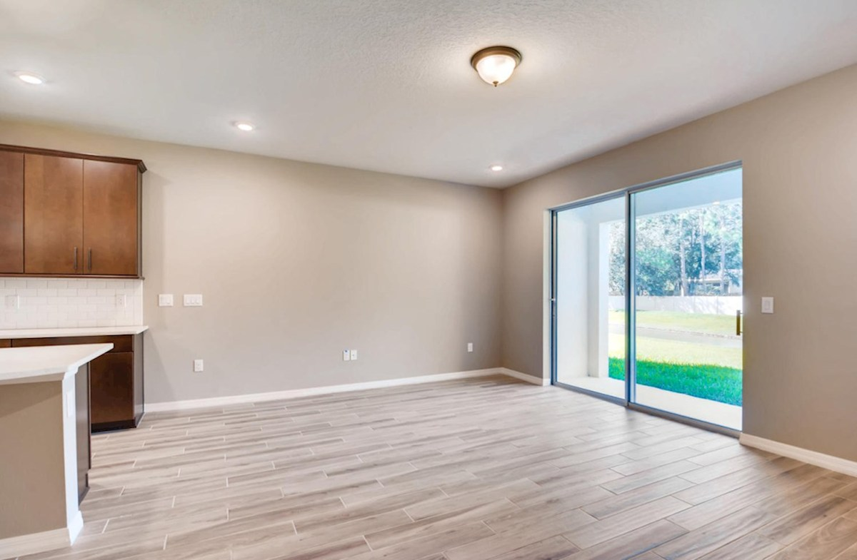Siesta Key quick move-in Great room with wood-look tile and sliding glass door