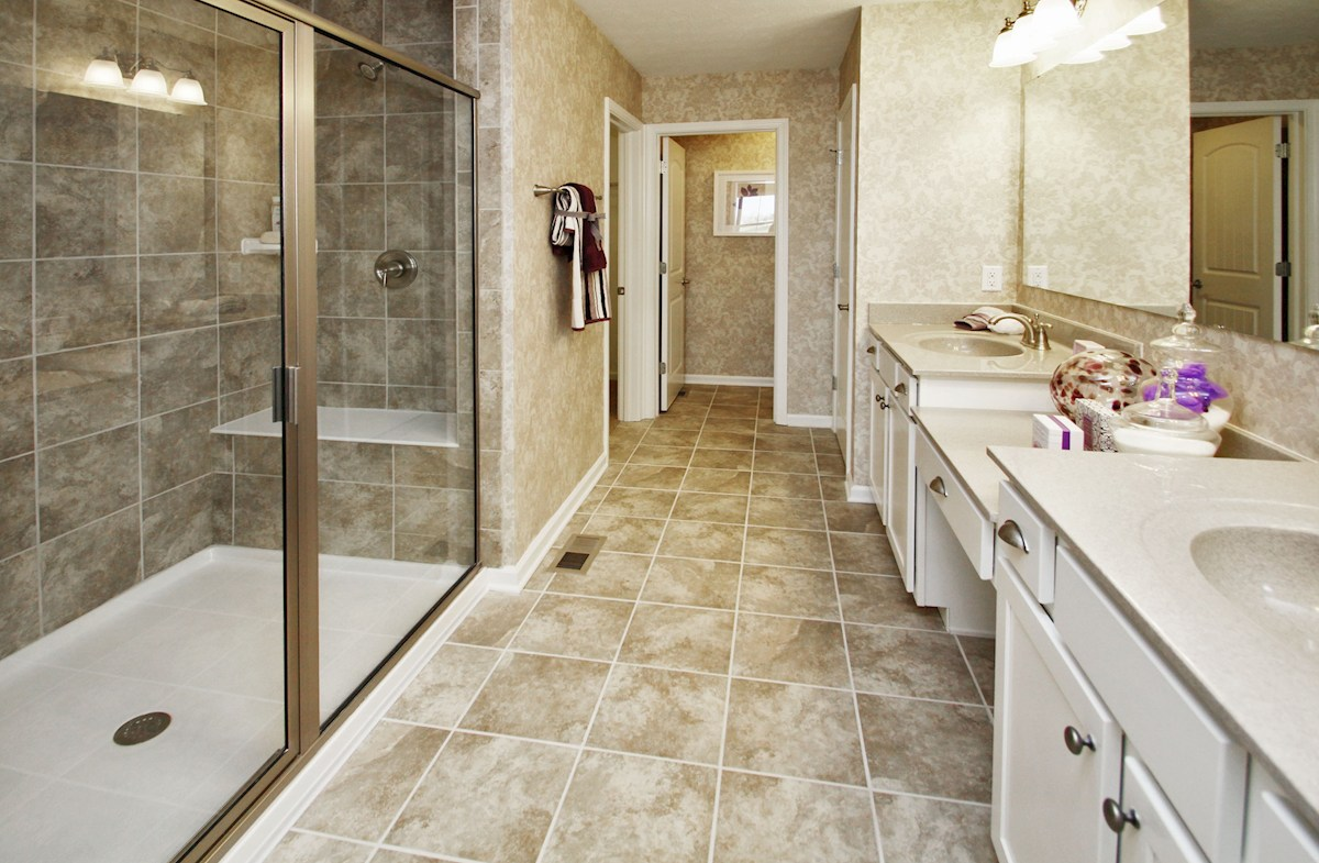 Heritage at Vermillion Bradley master bath with spa shower and dual sinks