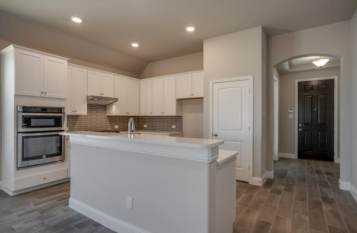 Silverado quick move-in Silverado kitchen with double ovens and large island