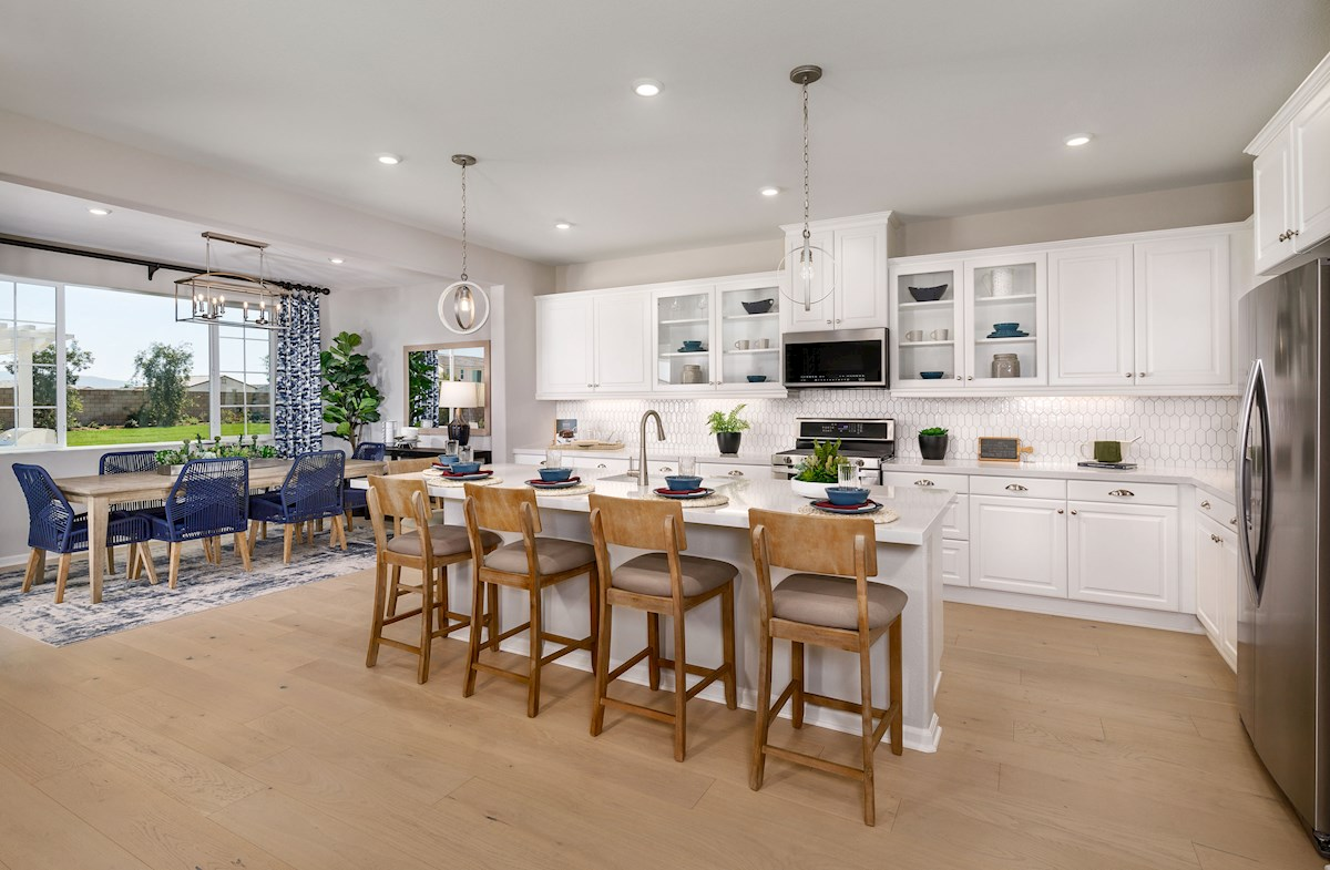 white kitchen with natural wood-like flooring