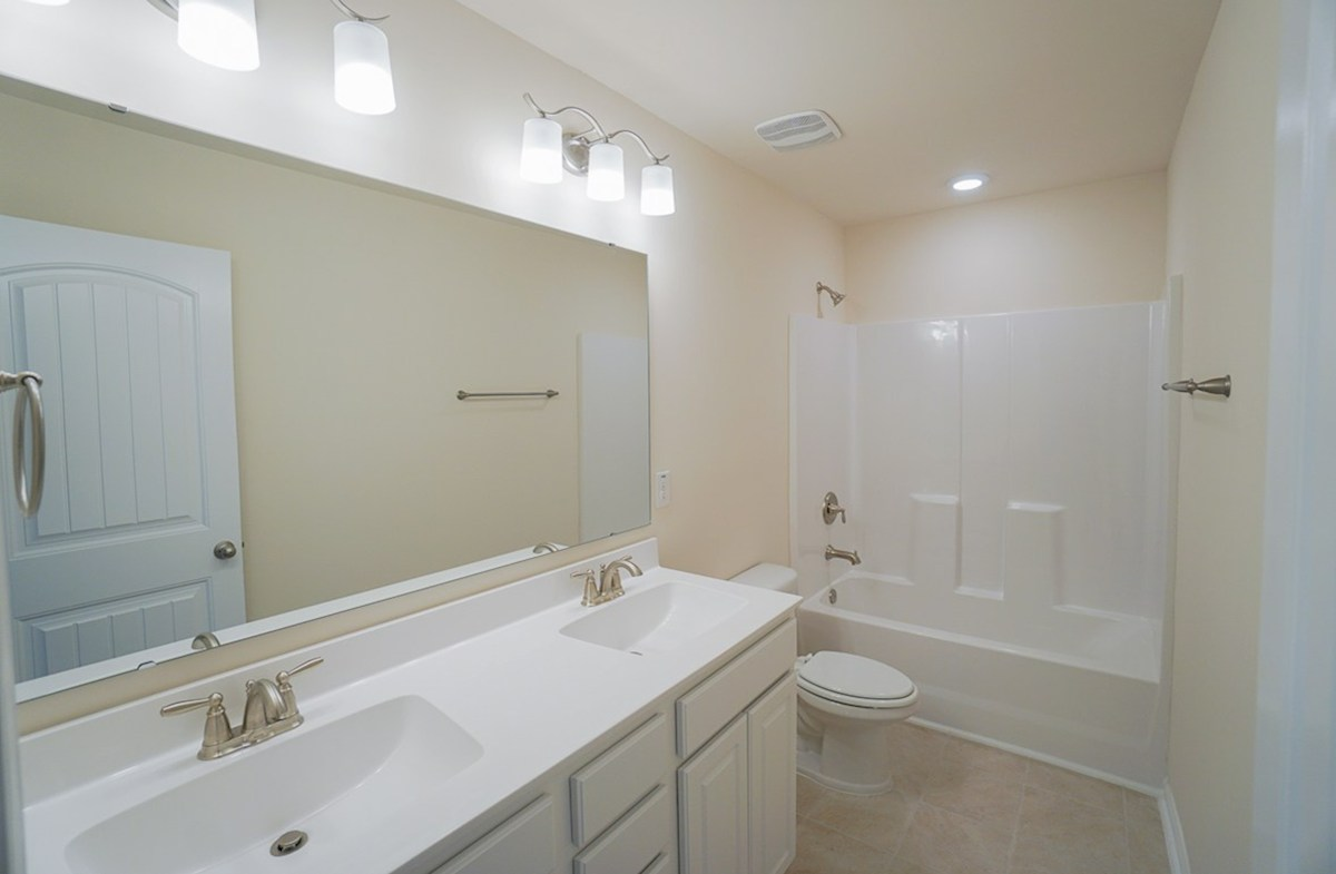 Ivey quick move-in secondary bathroom is ideal for guests with double vanities