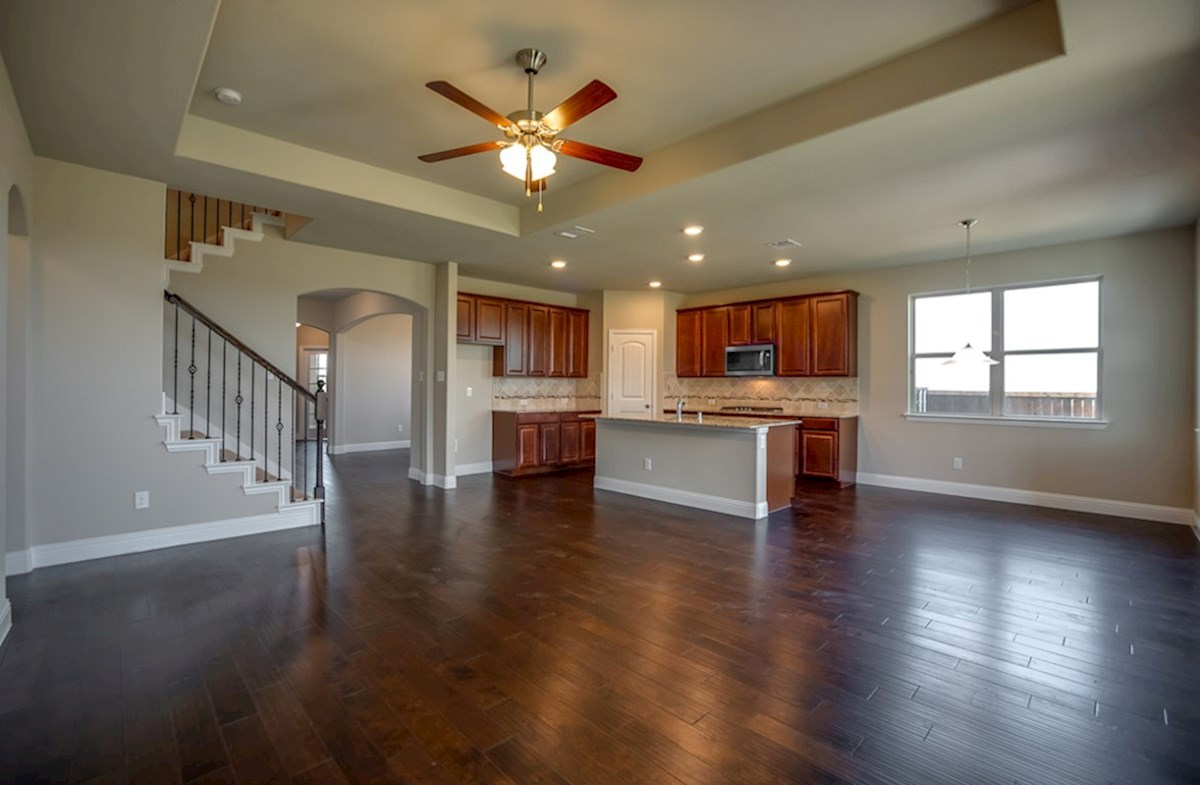Avalon quick move-in great room opens to kitchen and boasts wood flooring