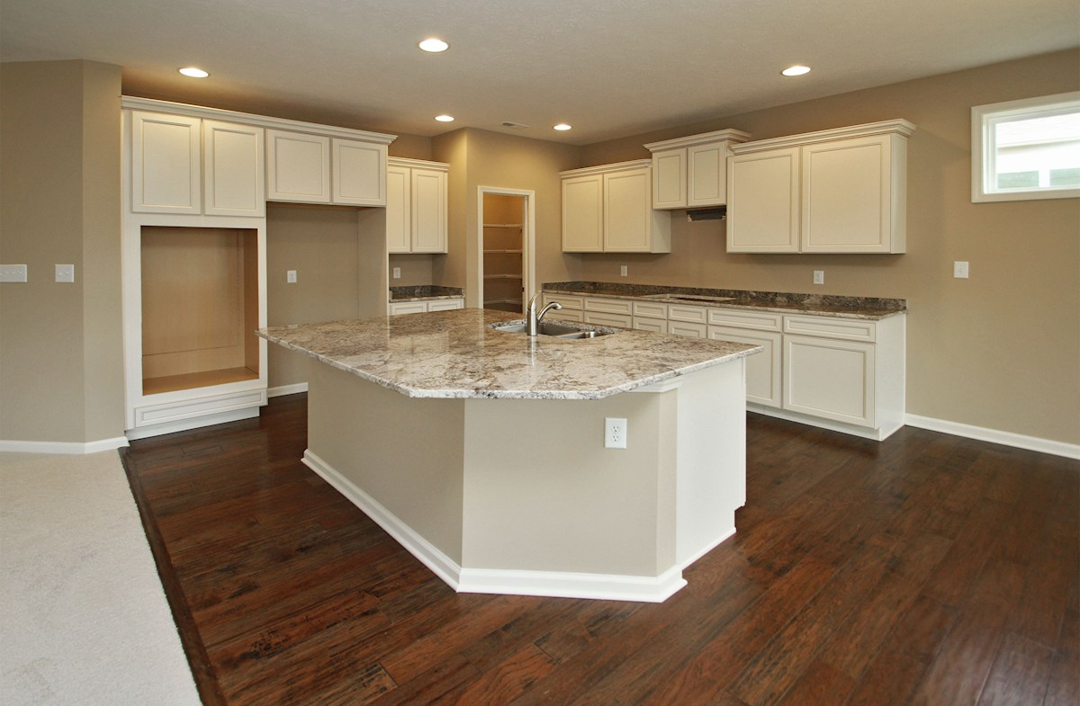 Reserve at Woodside Bradbury kitchen with walk-in pantry and large island with sink.