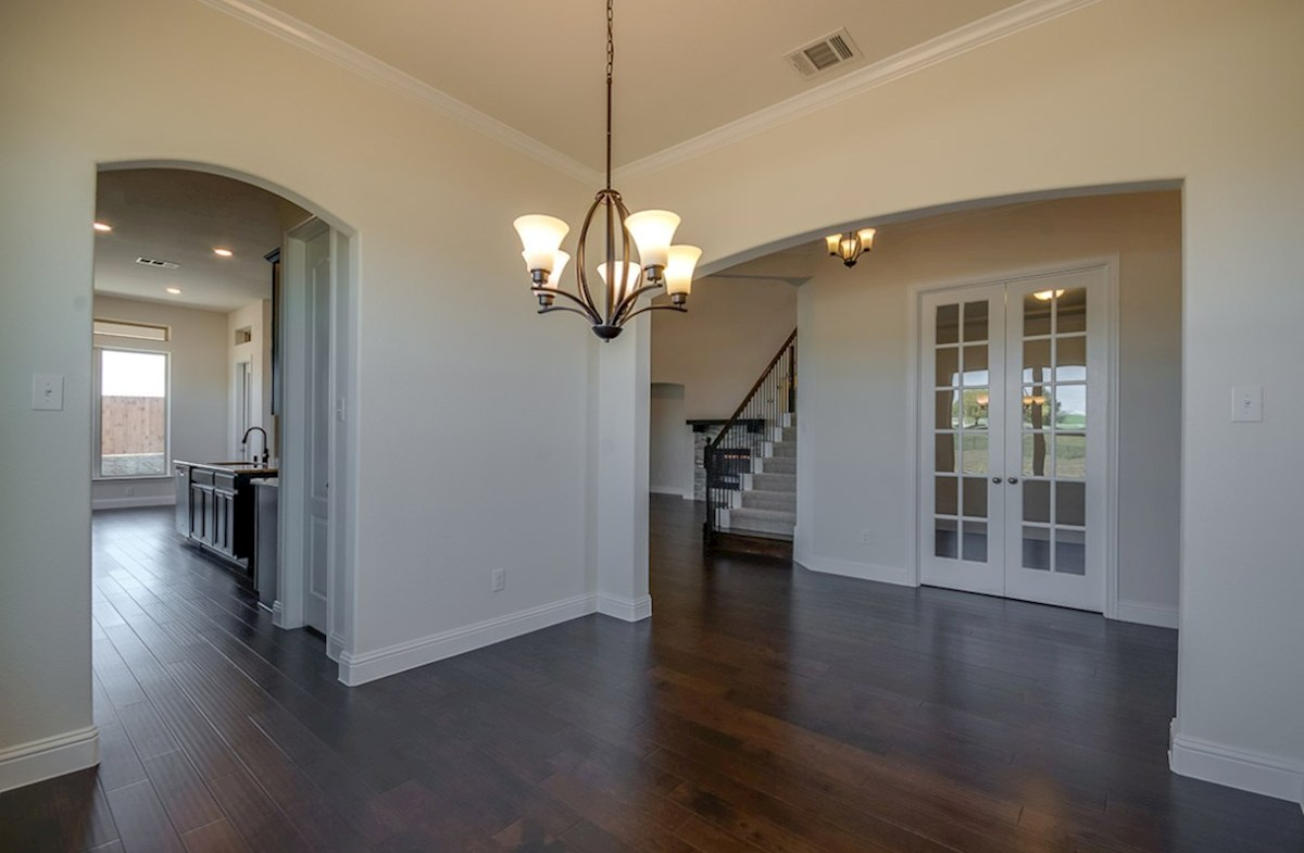 Kerrville quick move-in dining room with wood floors and archway