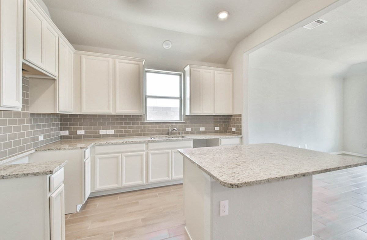 Maxwell quick move-in kitchen with granite counters and white cabinets