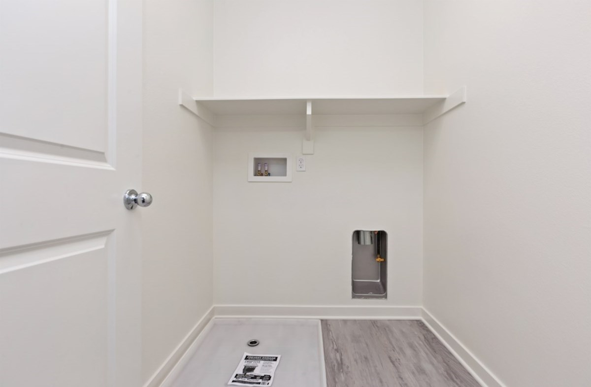 Primrose quick move-in Abundant storage in the convenient upstairs laundry room.