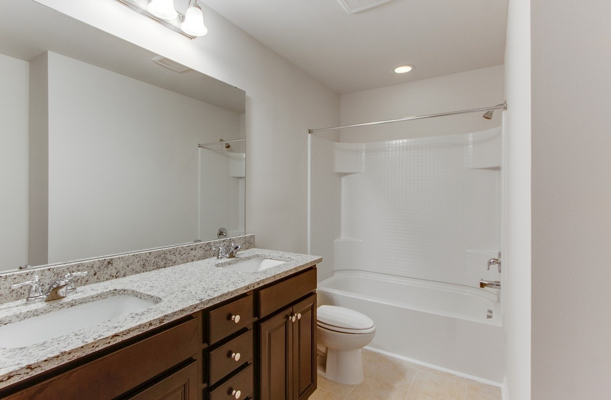 Jasmine Point at Lakes of Cane Bay Magnolia well-appointment secondary bathroom