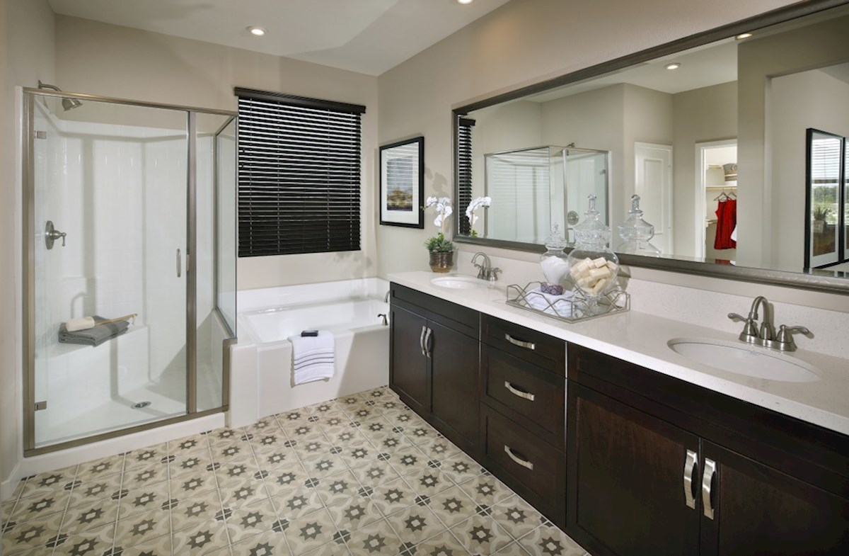 Barcelona Quartz Spa-inspired luxury abounds in the deluxe master bath, complete with separate shower and soaking tub