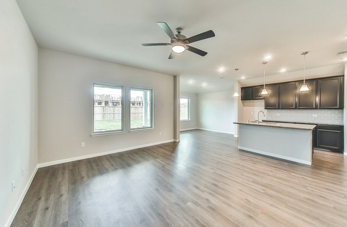 Sierra quick move-in great room with tall ceilings and ceiling fan