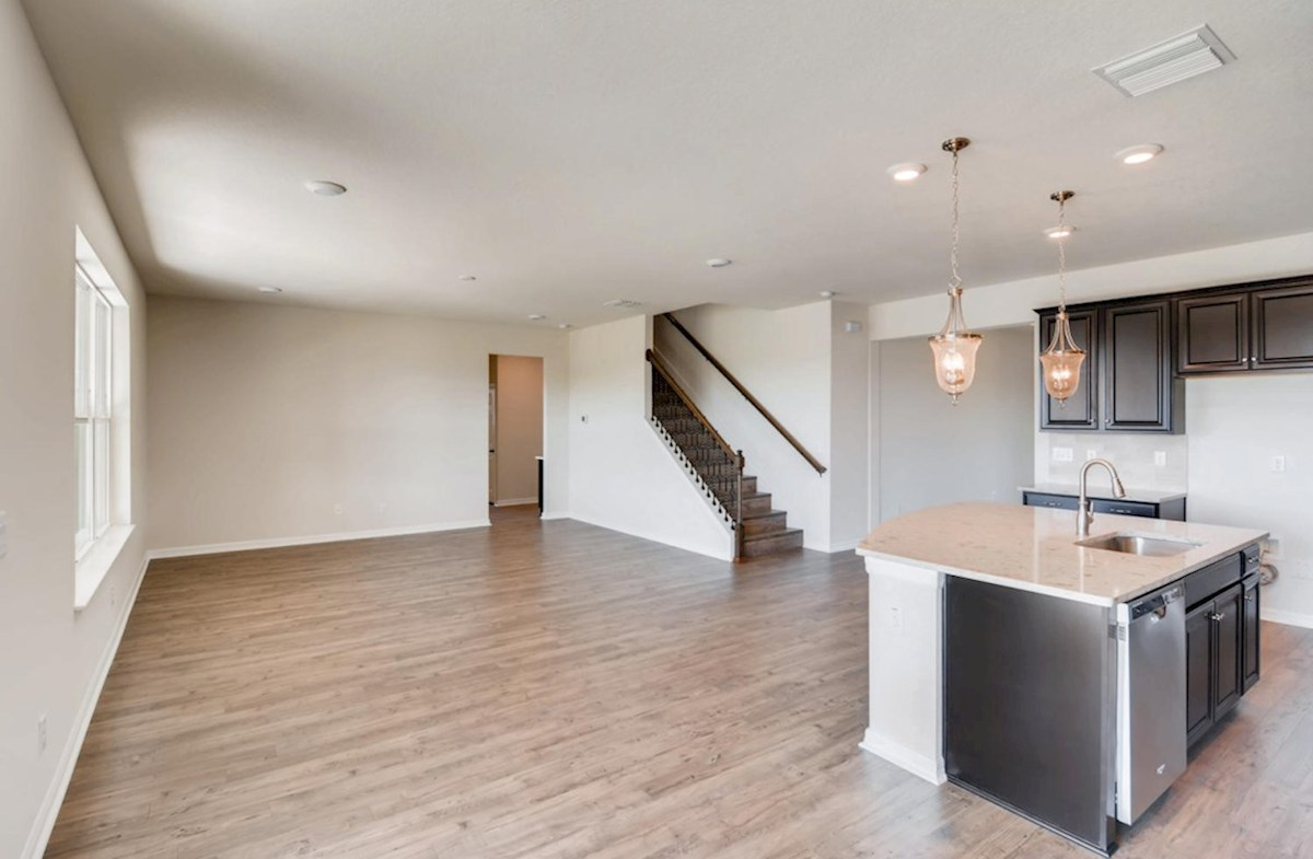 Sequoia quick move-in Kitchen island opens to the great room