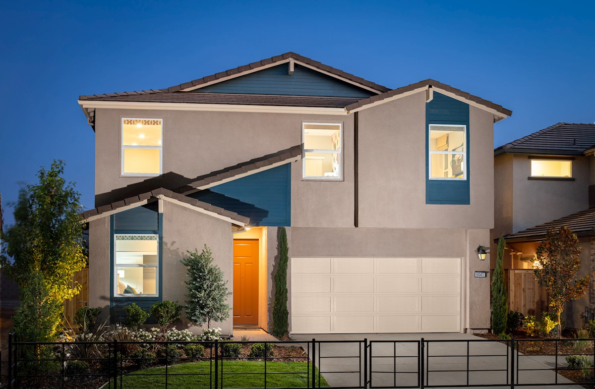 front exterior of two-story home with blue accents