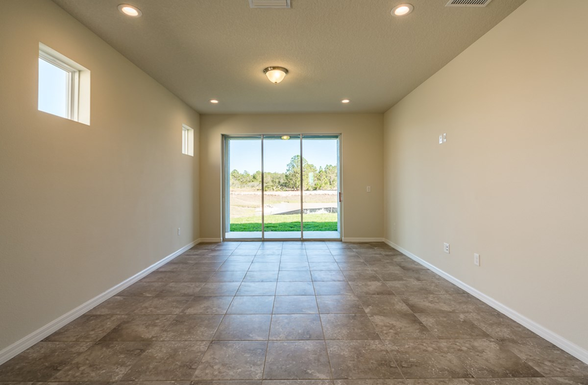 St Augustine II quick move-in Family room with access to covered lanai
