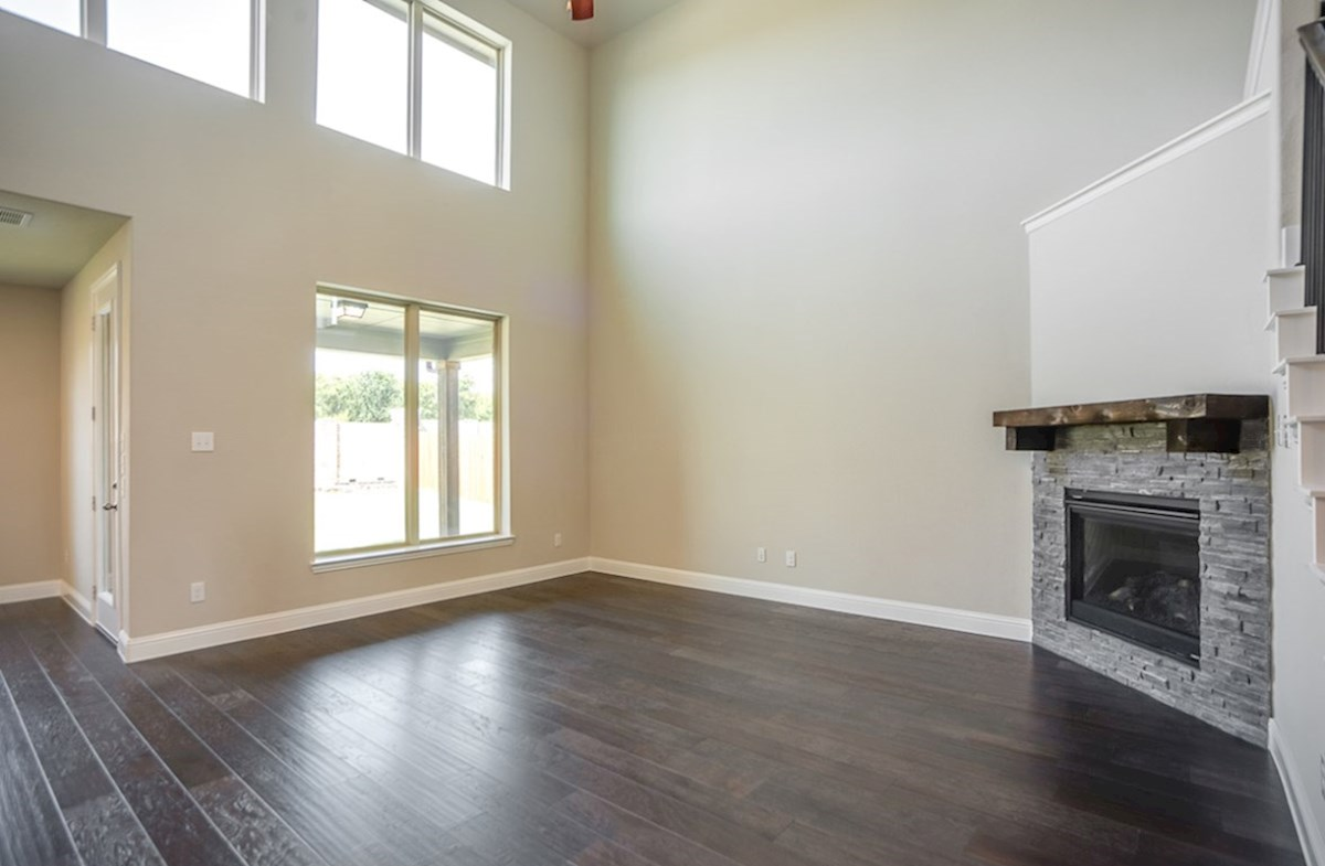 Brookhaven quick move-in great room with tall windows and fireplace