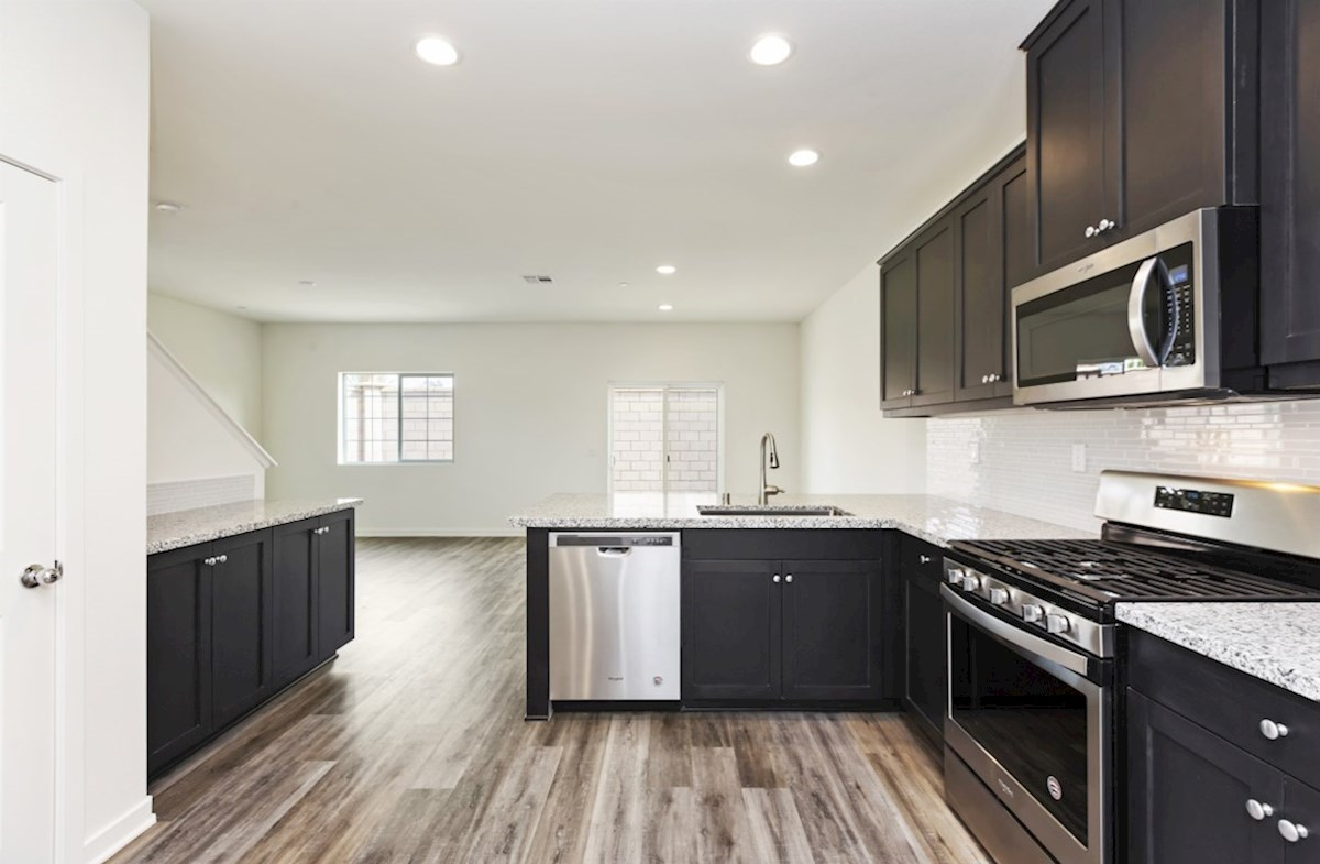 Bristol quick move-in Granite countertops and center island with sink provide the ideal location for food preparation