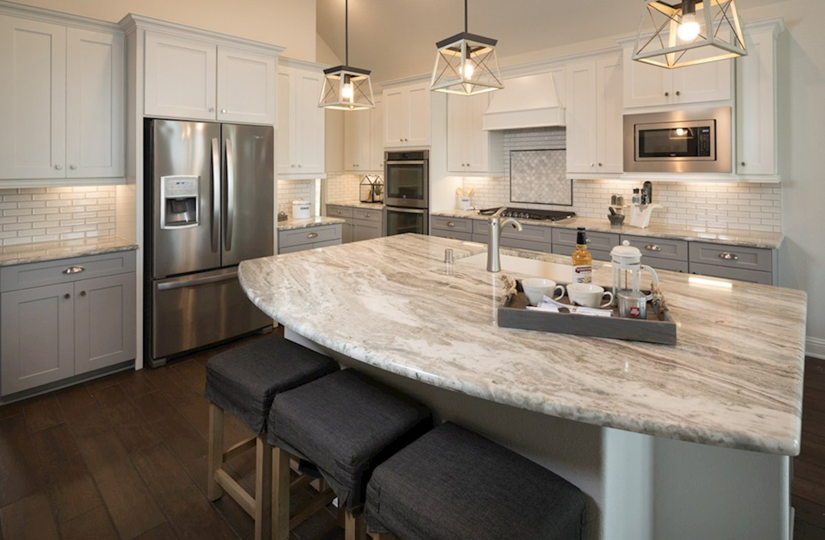 Amira  Harper kitchen with granite counters and white cabinets