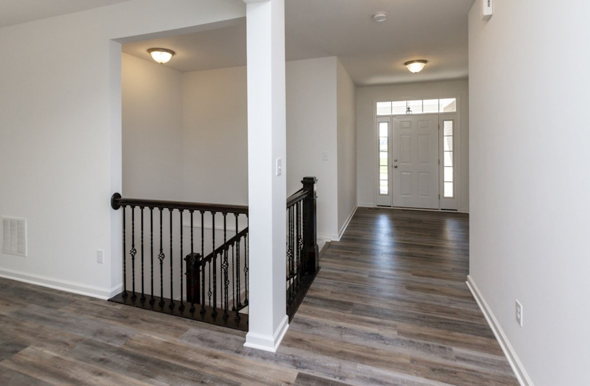 Greenwich quick move-in Welcoming foyer and stairs to basement