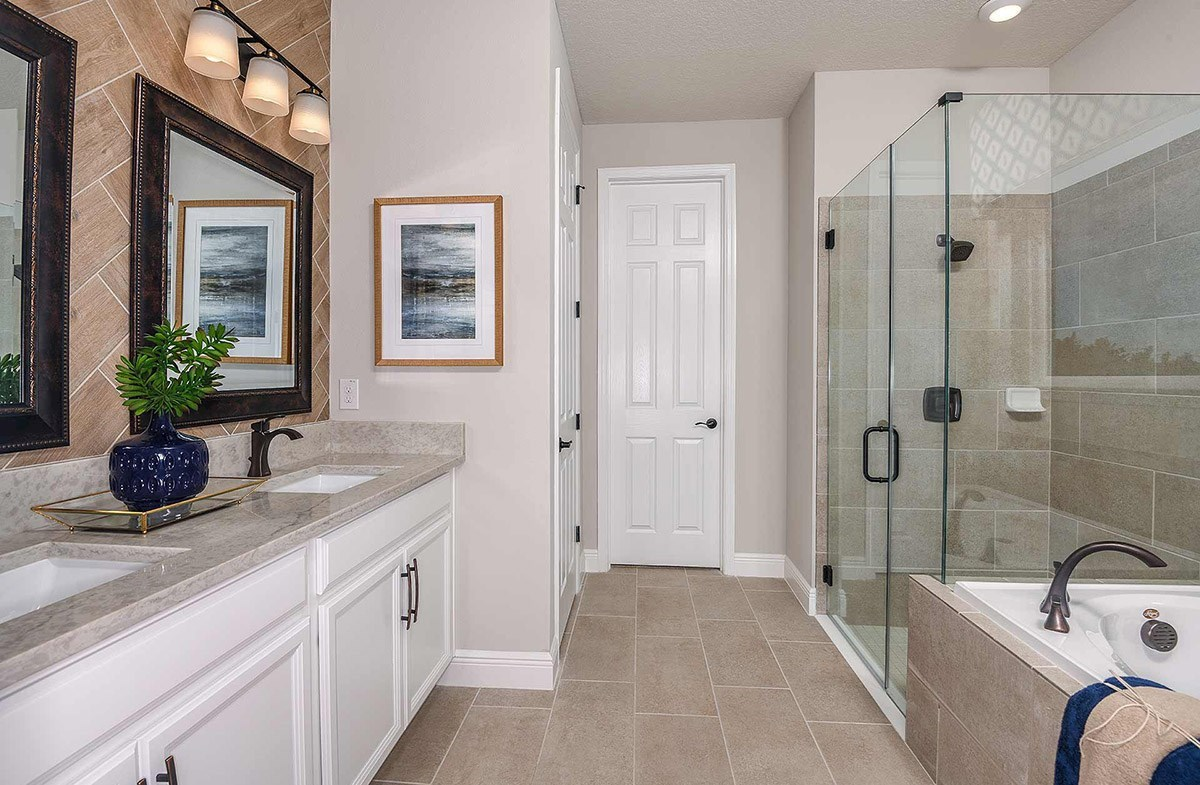 Waterset Bayview Master bathroom with glass enclosed shower and garden tub