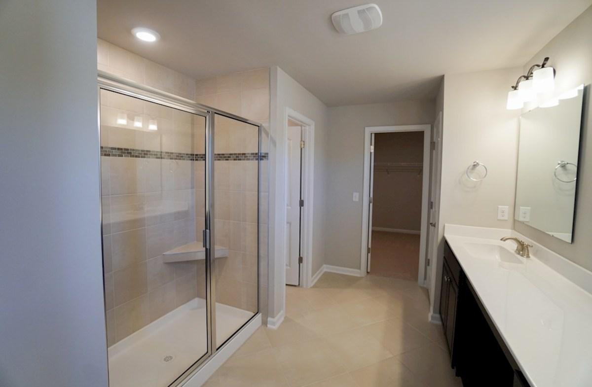 Edisto quick move-in master bathroom features a walk-in shower