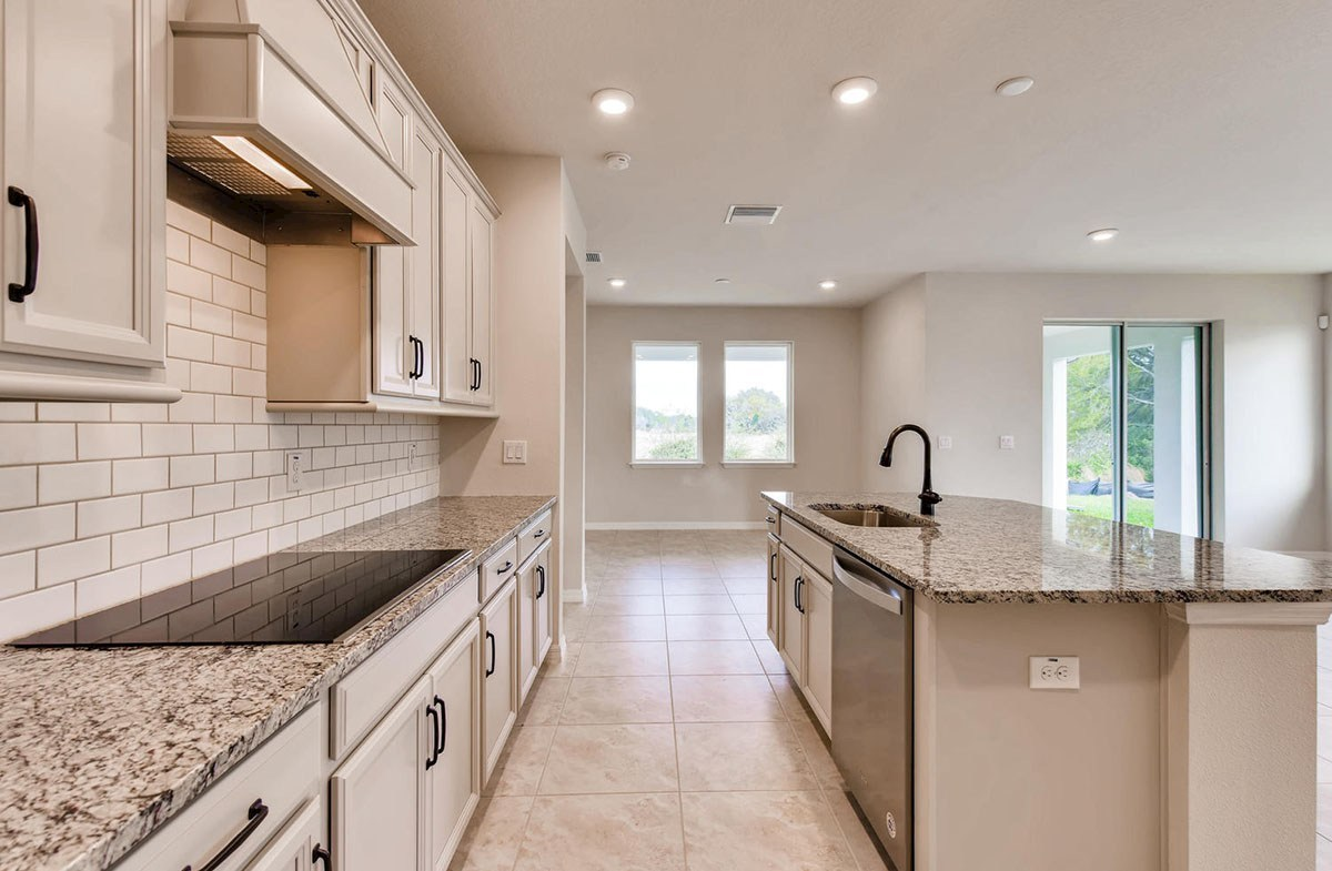 Sea Breeze quick move-in Open kitchen featuring center island with a sink
