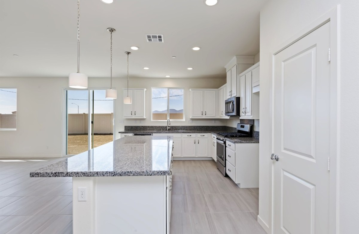 Piedmont quick move-in Granite countertops and center island with sink provide the ideal location for food preparation