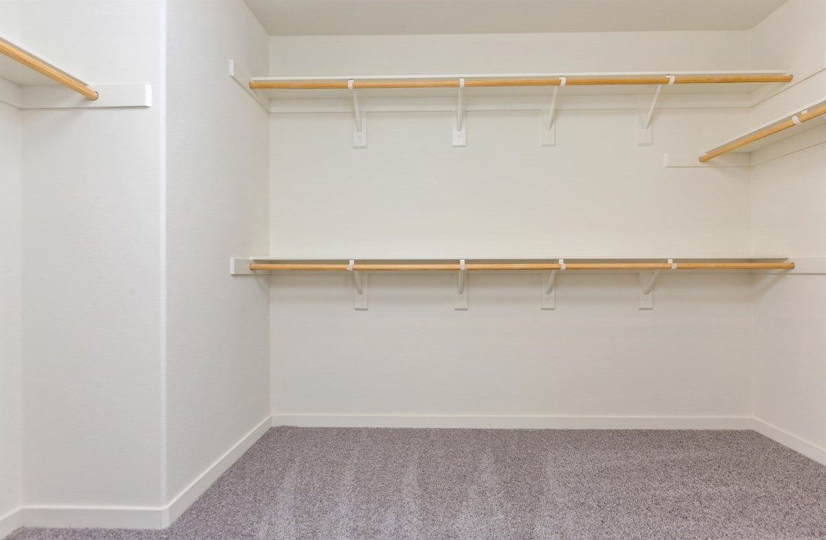 Hudson quick move-in Walk-in closet is designed for easy movement between shelves and optimal hanging and storage space